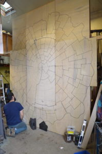 Mike working on laying patterns for the cast aluminum Slab wall sculpture tiles